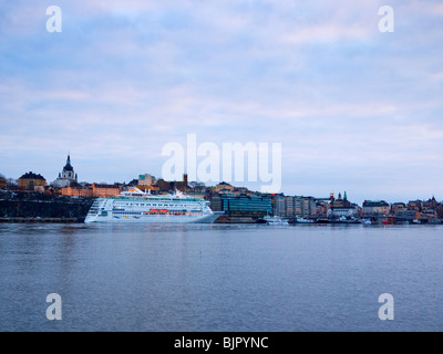 Cruise ship Birka Paradise (2004), now renamed Birka Stockholm, preparing to leave Stadsgårdskajen in Slussen, Stockholm, - Stock Photo