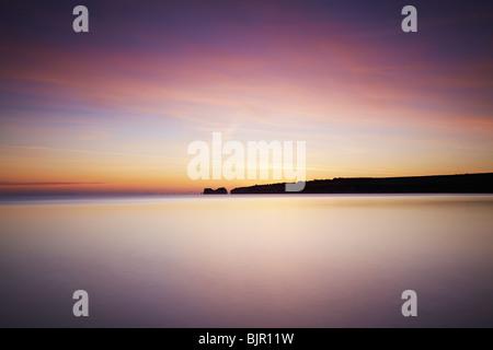 Sunrise over Old Harry Rocks, Studland, Dorset, UK - Stock Photo