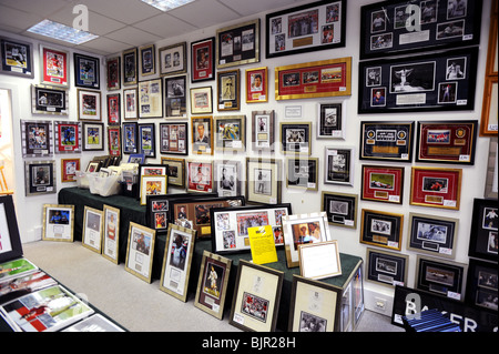 Autographed photo's and memorabilia hang in a shop in Haywards heath - Stock Photo