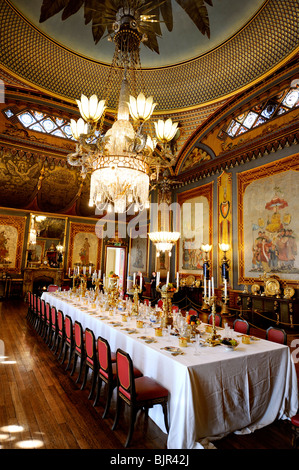 The huge dining table in the banqueting room at the Royal Pavilion, Brighton, East Sussex, UK. - Stock Photo