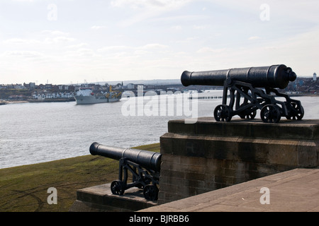 View from Collingwoods monument  at Tynemouth, north east  England. Overlooking the river Tyne. 2 of the 4 cannon's - Stock Photo