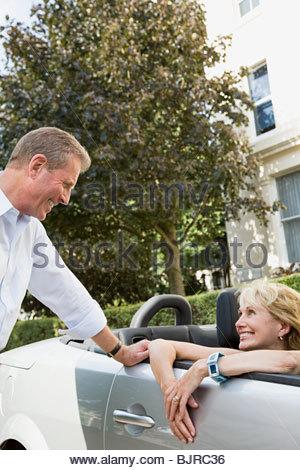 Senior couple with convertible - Stock Photo