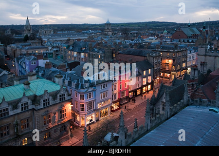 View of Oxford High Street and city rooftops from the viewing balcony of St Mary the Virgin Church in Radcliffe - Stock Photo