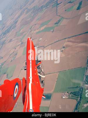 Two Red Arrows Hawks climb and loop vertically at sub-sonic speeds during an ISP (in-season practice) above Lincolnshire - Stock Photo