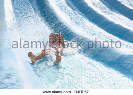 Girl on a water slide - Stock Photo