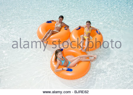 Girls on rubber rings - Stock Photo