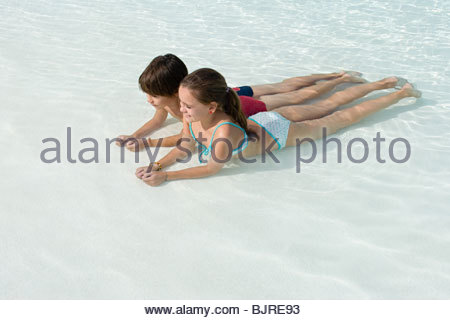 Boy and girl in a swimming pool - Stock Photo