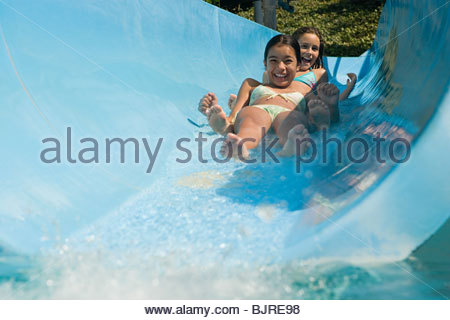 Girls on a water slide - Stock Photo