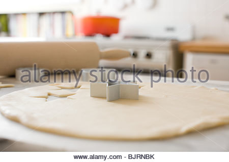 Cookie dough and pastry cutters - Stock Photo