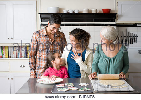 A family making cookies - Stock Photo