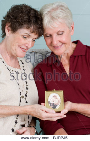 Senior friends with picture - Stock Photo