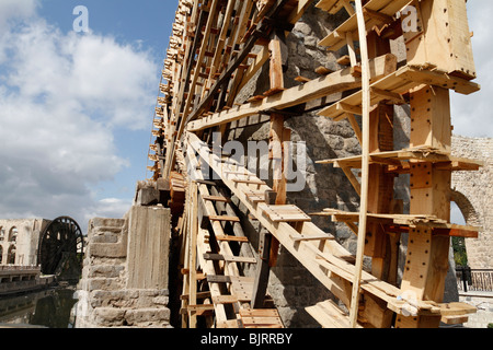 Close up of water wheel or noria in Hama, Syria - Stock Photo