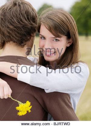 Teenage couple hugging - Stock Photo