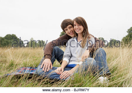 Young couple in a field - Stock Photo