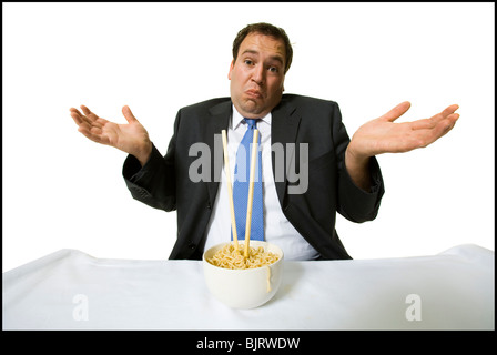 Businessmen eating noodles - Stock Photo