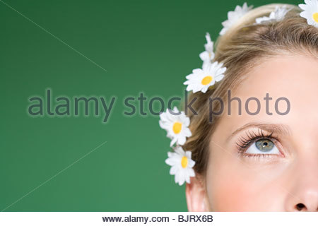 Woman wearing daisies in her hair - Stock Photo