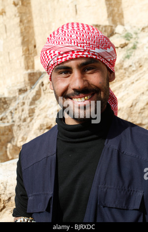 A smiling  bedouin showing gold teeth in Palmyra, Syria. - Stock Photo