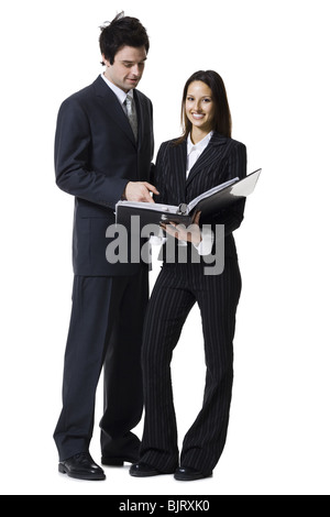 Businessman and businesswoman reviewing documents - Stock Photo