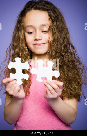 Young girl holding cookie jar - Stock Photo