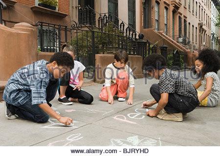 Kids drawing on sidewalk - Stock Photo