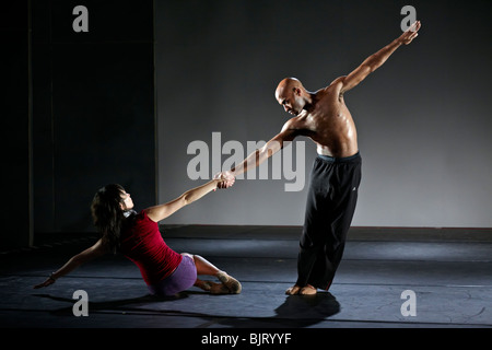 Male and female dancers of a modern dance touring group at a stage rehearsal. Thailand S. E. Asia - Stock Photo