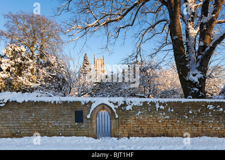 Winter snow on the Ernest Wilson Memorial Garden and St James church in the Cotswold town of Chipping Campden, Gloucestershire - Stock Photo