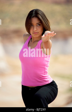 USA, Utah, Lake Powell, young woman exercising - Stock Photo
