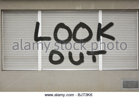 Graffiti on a shutter - Stock Photo
