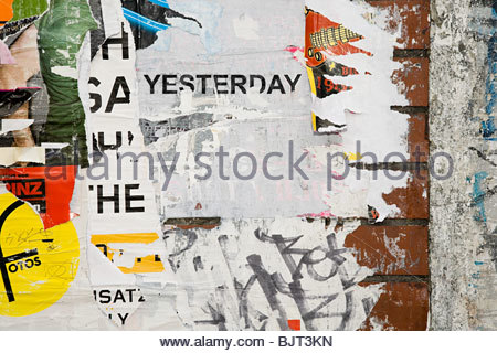 Torn posters on a wall - Stock Photo