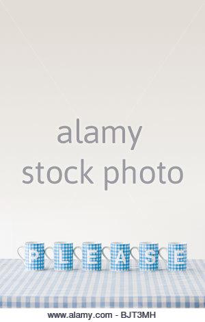 Please written on cups - Stock Photo