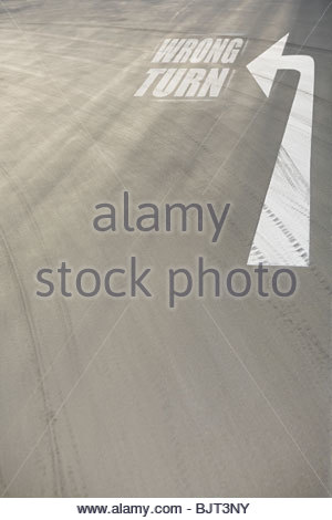 Direction arrow on the road - Stock Photo
