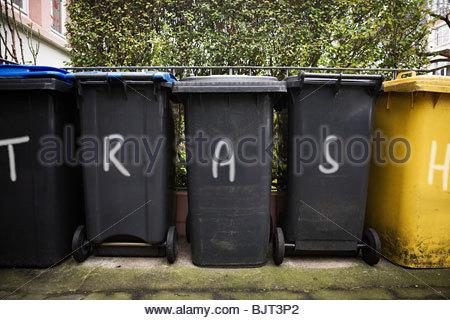 Graffiti on wheelie bins - Stock Photo