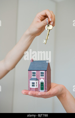People holding keys and house - Stock Photo