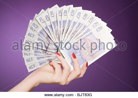 Hand fan of banknotes - Stock Photo