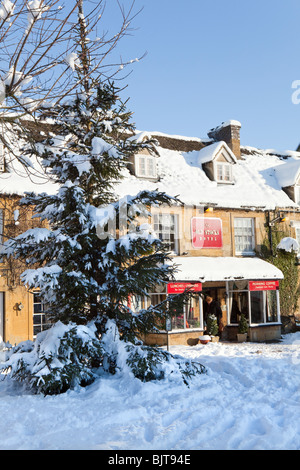 Winter snow on The Old Stocks Hotel in the Cotswold town of Stow on the Wold, Gloucestershire - Stock Photo