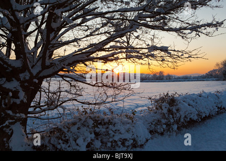 A winter sunset from the Cotswold lane between Stanton & Stanway, Gloucestershire - Stock Photo