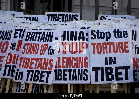A stack of pro Tibet placards before the Tibet Freedom March in London - Stock Photo