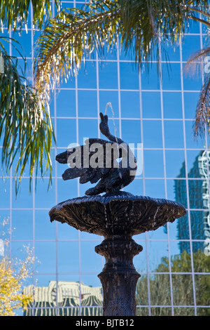 Fountain aganist glass modern building in downtown Orlando Florida - Stock Photo