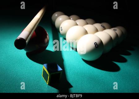 Billiard 'Russian Pyramid' equipment on a table in light beam. - Stock Photo