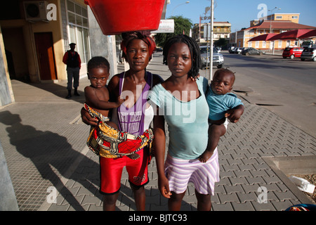 Portrait of young mothers street sellers carrying babies and buckets. Benguela city, Angola. Africa. - Stock Photo