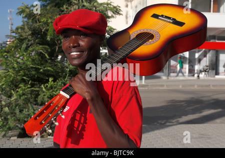 Portrait of man on the street carrying a guitar. Benguela. Angola. Africa.  © Zute Lightfoot. www.lightfootphoto.co.uk - Stock Photo