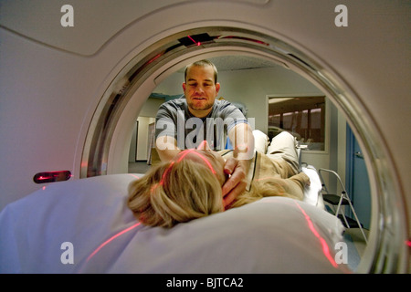 A medical technician prepares a patient for a CT examination at a California radiology clinic using a multi-slice - Stock Photo