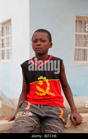 Young boy wearing an Angolan T-shirt displaying the national colours and symbol. Benguela. Angola. Africa. © Zute - Stock Photo