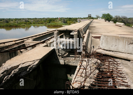 War damage remains on one of the many hydroelectric dams on the Cunene river. Cunene Province, Southern Angola, - Stock Photo