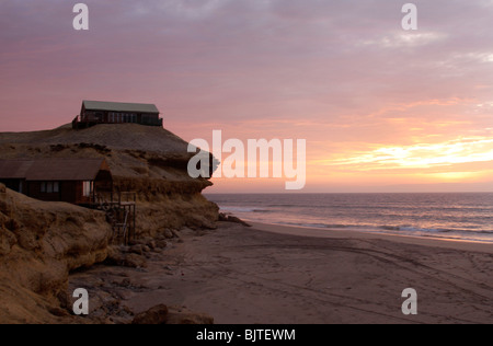 Flamingo Lodge, a fishing lodge in the  Reserva De Namibe, Nr Iona National Park, Namibe Province, Southern Angola. - Stock Photo