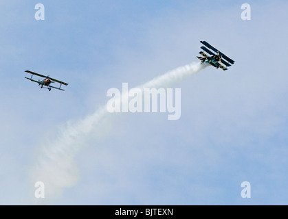 World War 1 dog fight reancctment at air show in UK Sopwith Cannel and Fokker Triplane. - Stock Photo