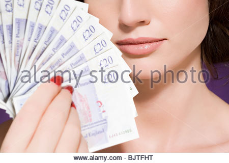Woman holding banknotes - Stock Photo