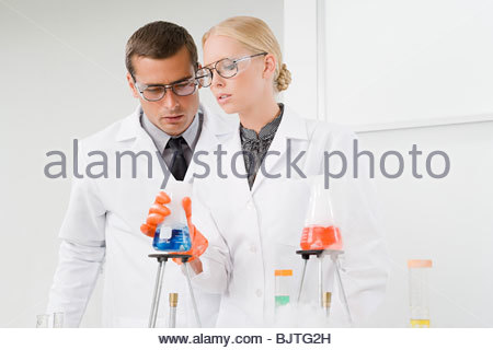 Scientists conducting an experiment - Stock Photo