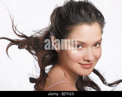 Portrait of young brunette woman - Stock Photo