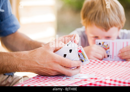 Father and son playing card game - Stock Photo